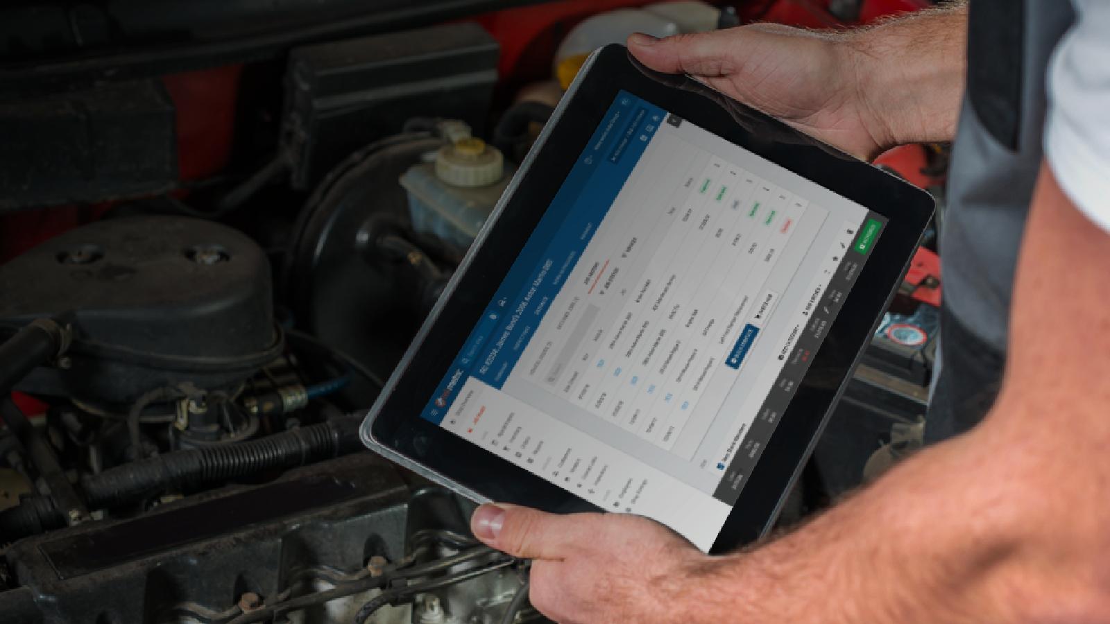 Mechanic Using Tekmetric on Tablet
